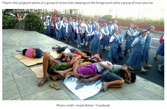 Children sleeping nuns passing by